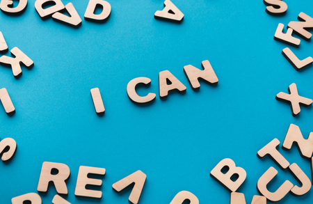 I can phrase in wooden letters frame on blue background. Success and challenge concept. Stock Photo