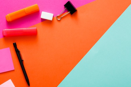 Minimal design. Top view of modern creative workspace with various stationery. Abstract colorful background with copy space