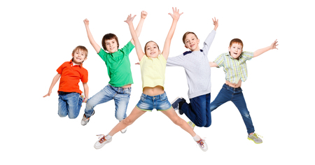 Group of happy, cheerful children jumping at isolated white studio background. Childhood and freedom, active lifestyle concept, copy space