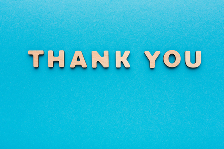 Phrase Thank You on blue background. Politeness, thanks, gratitude concept Stock fotó