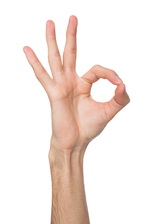 Hand showing OK sign isolated on white background. Close-up of positive gesture, like, agreement, accept concept Stock Photo