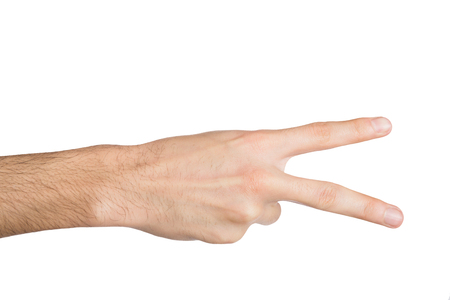 numeric: Male hand shows number two isolated on white background. Counting gesturing, enumeration, close-up, cutout, copy space Stock Photo