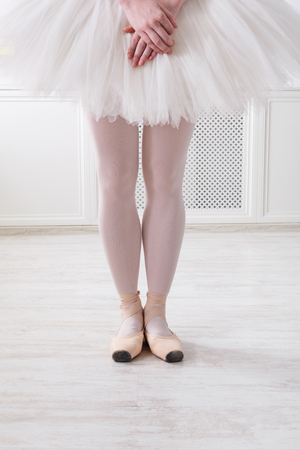 Ballerina legs in sixth position on pointe, ballet dancer closeup background, copy space Stock Photo