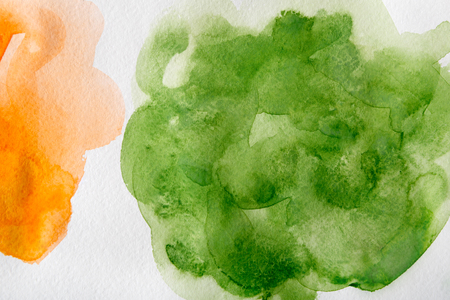Abstract watercolor yellow and green spot painted texture background. Stock Photo