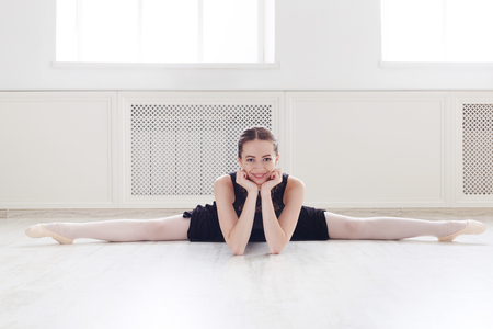 Beautiful Ballerina Doing Side Splits And Smiling On Camera    Stock