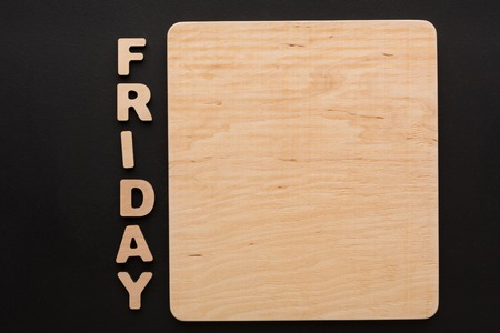 english letters: Word Friday with blank wooden board. Timetable, day of week, to-do-list, time management concept Stock Photo