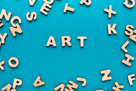 english letters: Word Art on blue background, in wooden letters frame. Creativity, craftsmanship, modern life concept