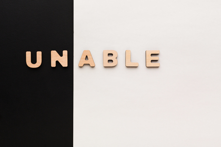 english letters: Positive motivation concept. Changing word unable into able Stock Photo