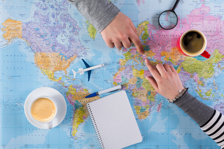 Couple Planning Airplane Trip To USA Point On Map Woman Taking