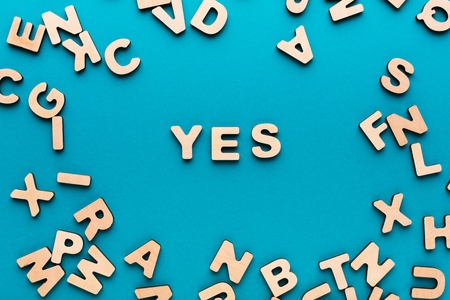 Word Yes On Blue Background In Wooden Letters Frame Agreement
