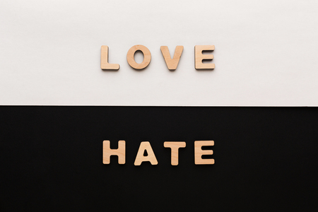 Words Love and Hate on contrast background. Opposite feelings, strong emotions concept