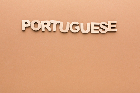english letters: Word Portuguese on beige background. Foreign language learning, education concept Stock Photo