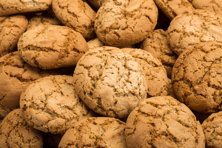 Cookies background. Oatmeal biscuits texture background. Fattening sweets concept