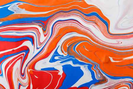 Liquid marbling paint background. Fluid painting abstract texture. Colorful mix of acrylic vibrant colors.