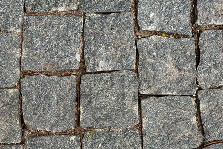 화강암 자갈 배경입니다. 모자이크 포장 패턴, 회색 돌 배경에 상위 뷰