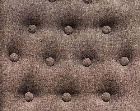 button tufted: Chesterfield styled furniture with buttons close up. Decorated sofa back background