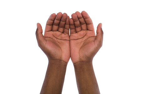 Two hand holding or offering something, isolated on white background. Open black male palms, handful gesture Banque d'images