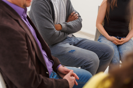 Trust circle. Company of unrecognizable people sitting together. Meeting of support group, copy space