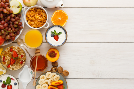 Rich continental breakfast menu background. Delicious natural food for tasty morning meals on wooden table, traditional european buffet, copy space