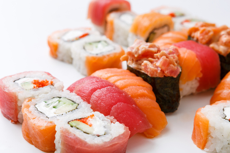 Gunkan, salmon and philadelphia sushi rolls - asian food restaurant delivery, closeup of platter set on white background and copy sapce Stock Photo