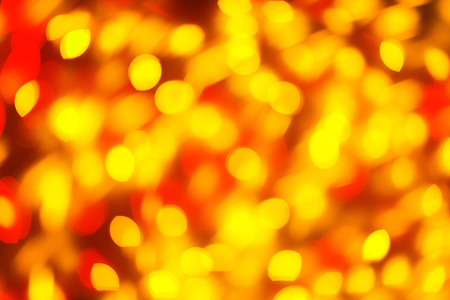 Red and yellow color light blurred background, unfocused. Christmas or other holiday decorations, garland illumination bokeh Stock Photo