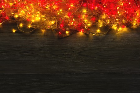 christmas red and yellow lights background copy space holiday shiny garland border top view