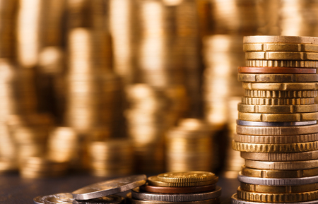 Golden coin stacks, rich money background. Financial success, cryptocurrency mining, banking and profit concept Standard-Bild