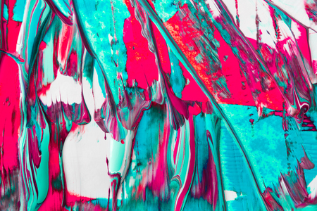 Draining liquid marbling paint background. Fluid painting abstract texture, art technique. Dripping colorful mix of acrylic vibrant colors