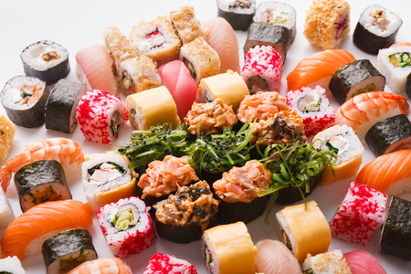 Sushi and rolls pattern background, restaurant delivery closeup. Salmon, unagi, california and other healthy meals. Traditional japanese cuisine backdrop