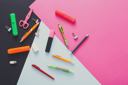 Stationery supplies and devices - top view, flat lay, mockup of creative work space at modern office with markers, rubbers, pens, scissors and binder clips, nobody, objects, copy space