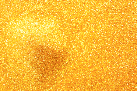 Golden glitter pile, handful spread, abstract luxury background with copy space. Yellow dusty shimmer decoration heap, top view. Holiday and glamour concept. Reklamní fotografie