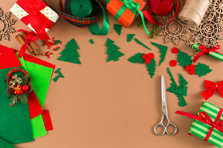 Creative diy xmas hobby background. Handmade tools for making christmas present and trappings, flat lay style. Top view of craft paper table with copy space, decoration of gift.