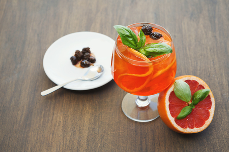 Traditional italian spritz cocktail. Soft drink with red bloody orange, prosecco and pine cones confiture. Exclusive bar menu concept, copy space Stock Photo
