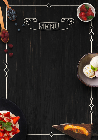 Design concept for restaurant dessert menu mockup. Black rustic wooden board with white inscription and sweet snacks, top view, copy space for text Foto de archivo