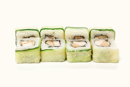 Sushi japanese restaurant delivery. Set of green cucumber rolls with fish and philadelphia cheese isolated on white background closeup, copy space. Healthy seafood, cutout for menu