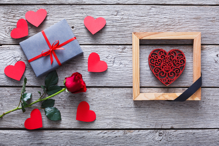 End of love and anti valentine day background. Red glitter heart in wooden frame with black ribbon. Breaking the relationships, separation and divorce, i hate valentine concept, top view Stock Photo