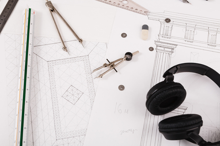 Engineering blueprint, headphones and divider for creating new architectural project on table, copy space Banque d'images