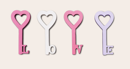 Key from love isolated on white. Happy Valentines Day background with heart in keys form pastel pink and violet decorations, copy space