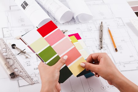 Interior designer working with color palette closeup. Architect choosing colors for building decoration, copy space Stock Photo
