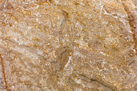 Solid sand colored stone closeup, natural material, background and texture, closeup