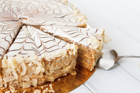 Closeup of sliced esterhazy cake. Delicatessen sweet dessert with almond meringue dough and buttercream, traditional hungarian, austrian cuisine. 스톡 콘텐츠