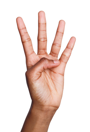 Black female hand shows number four isolated. Counting gesturing, enumeration, white background Stock Photo