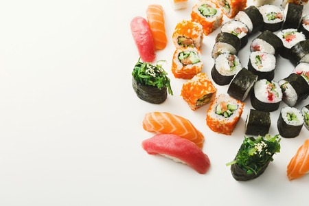 Salmon and philadelphia sushi rolls - asian food restaurant delivery, platter set on white background, copy space Фото со стока