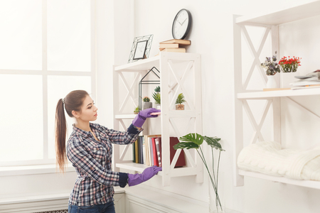 Woman Cleaning Dust From Bookshelf Young Girl Sweeping Shelf Fascinating Best Way To Dust Furniture Concept