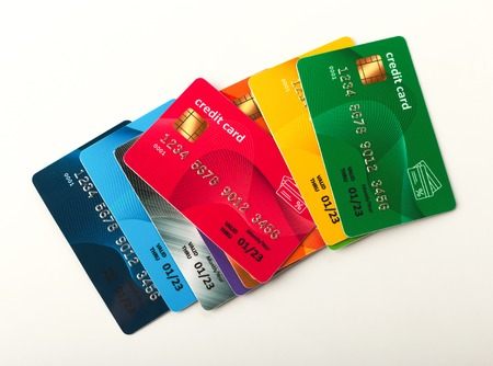 Collection of colourful credit cards isolated on white background. Finance, well-being, modern payment systems, online shopping concept, top view