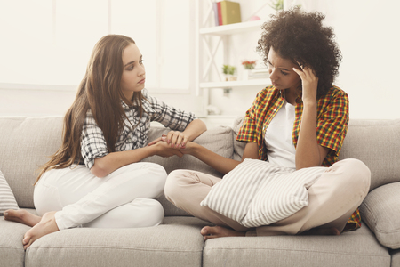 Two women talking about problems at home. Friendship consoling and care, unhappy girl support her girlfriend, copy space Stock Photo