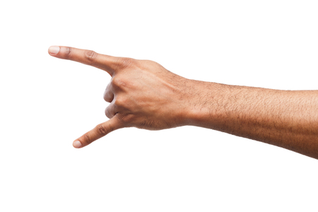 Male black hand making rocknroll gesture, close up, isolated on white backgroung Stock Photo