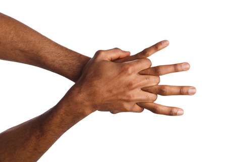Black male hands showing protection concept, isolated on white background