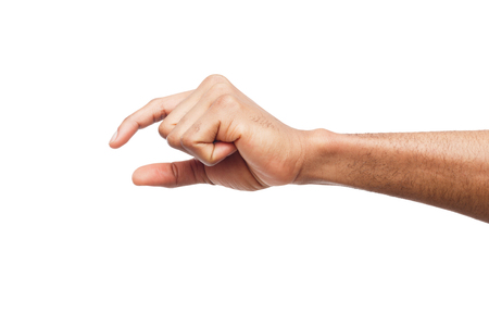 Black male hand measuring invisible items, mans palm making gesture while showing small amount of something on white isolated background Stock Photo