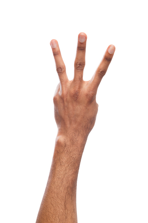 Black hand showing number three isolated. Counting gesturing, enumeration, white background Stock Photo